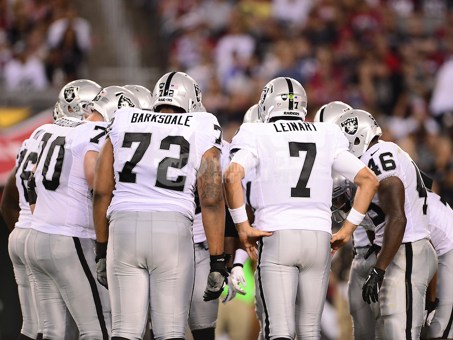 Aug. 17, 2012; Glendale, AZ, USA; Oakland Raiders tackle (72) Joe Barksdale and quarterback (7) Matt Leinart in the huddle against the Arizona Cardinals during a preseason game at University of Phoenix Stadium. The Cardinals defeated the Raiders 31-27. Mandatory Credit: Mark J. Rebilas-