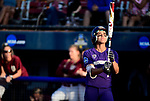 OKLAHOMA CITY, OK - JUNE 04: Taryn Atlee #7 of the Washington Huskies collects herself before her at bat against the Florida State Seminoles during the Division I Women's Softball Championship held at USA Softball Hall of Fame Stadium - OGE Energy Field on June 4, 2018 in Oklahoma City, Oklahoma. (Photo by Tim Nwachukwu/NCAA Photos via Getty Images)