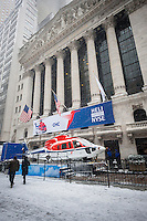 A Sikorsky S-76 helicopter is parked on a truck outside the New York Stock Exchange in Lower Manhattan in New York to celebrate the IPO (Initial Public Offering) of the CHC Group Ltd. on Tuesday, January 21, 2014. The CHC Group Ltd. is a Canadian based company that provides helicopter flying, maintenance and repair services, particularly to the oil and gas industries. The company operates 238 aircraft in 30 countries.  (© Richard B. Levine)