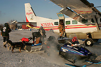 Wednesday March 7, 2007    Veterinarians and helpers bring dropped dogs to a waiting Pennair plane at the Nikolai checkpoint on Wednesday in 35 below temperatures