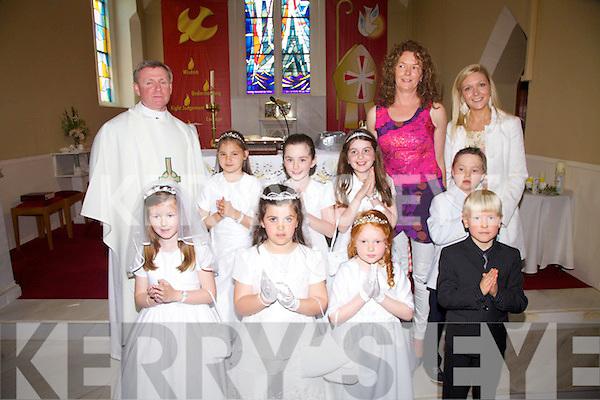 Making their First Holy Communion on Saturday in St Michaels Church Dungeagan, were the pupils from Scoil Mhíchíl, Dungeagan pictured front l-r; Shauna Gugán,Megan Ní Shé, Saoirse Ní Bhrian, Jake Warburton, back l-r; Fr. David Gunn, Muirinn Ní Chonaill, Molly Ní Chonnroí, Cadhla Ní Ghiní, Síle Uí Shiochrú, Alex Ó Conchúir agus Laura Nic Giolla Phádraig.