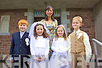First Holy Communion: Pictured outside Foilmore church on Saturday were the pupils from Foilmore N.S. l-r Dylan Keating, Saoirse O'Connor, Ellen O'Sullivan, Cathal Moriarty & Ms Nora Golden Principal.
