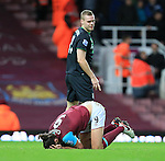 West Ham's Andy Carroll tussles with Stoke's Ryan Shawcross<br /> <br /> Barclays Premier League - West Ham United v Stoke City - Upton Park - England -12th December 2015 - Picture David Klein/Sportimage