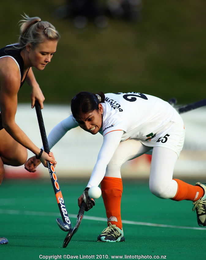NZ's Charlotte Harrison beats the tackle of Joydeep Kaur Saggu during the International hockey match between New Zealand Black Sticks and India fifth test at National Hockey Stadium, Wellington, New Zealand on Sunday, 23 May 2010. Photo: Dave Lintott / lintottphoto.co.nz
