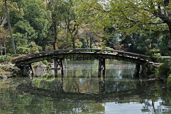The Shinsetsu-kyo bridge which crosses the water in the Shosei-en garden