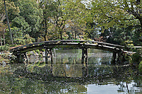 The Shinsetsu-kyo bridge which crosses the water in the Shosei-en garden