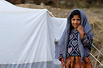 Following an October 8, 2005, earthquake, a girl lives in a tent city outside Balakot.