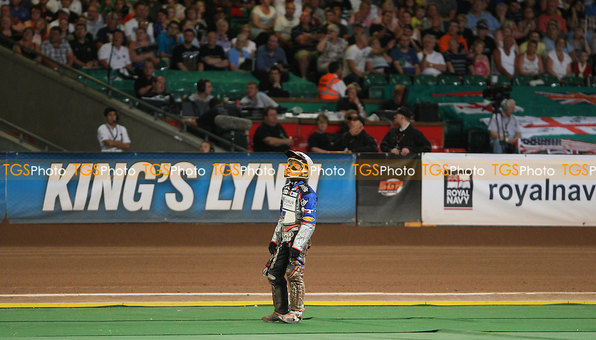 Davey Watt watches the big screen after being excluded in Heat 19 - British Speedway Grand Prix at the Millennium Stadium, Cardiff - 10/07/10 - MANDATORY CREDIT: Rob Newell/TGSPHOTO - Self billing applies where appropriate - 0845 094 6026 - contact@tgsphoto.co.uk - NO UNPAID USE.