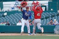 Frisco RoughRiders first baseman Ronald Guzman (11) stretches for a throw as Johan Mieses (41) runs through the bag during a Texas League game against the Springfield Cardinals on May 5, 2019 at Dr Pepper Ballpark in Frisco, Texas.  (Mike Augustin/Four Seam Images)