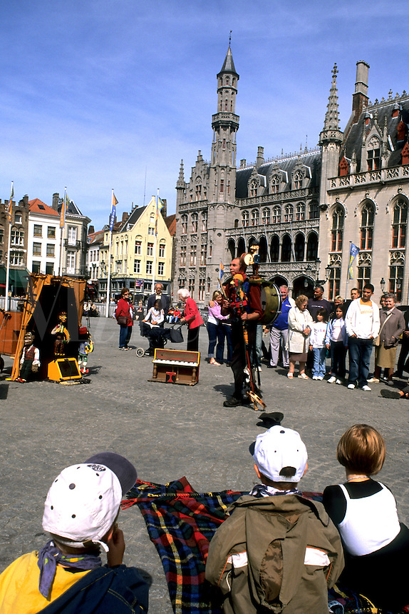Belgium Market Place in center with puppet man performer in the colorful city of Bruges