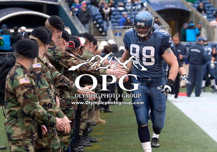 13 Nov 2005:  Seattle Seahawks defensive end Grant Wistrom lead the defensive line onto the field giving high five's to military personal from Fort Lewis who were injured while serving over seas. The Seattle Seahawks honored military personal during Veterans day weekend before the start of the game against the St. Louis Rams at Quest Field in Seattle, WA.