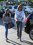 .June 22nd  2012..Cindy Crawford shopping with her daughter at Planet Blue in Malibu California wearing a butterfly shirt ...AbilityFilms@yahoo.com.805-427-3519.www.AbilityFilms.com