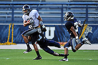 12 August 2011:  FIU's Jacob Younger (88) attempts to break away from Chuck Grace (21) during a scrimmage held as part of the FIU 2011 Panther Preview at University Park Stadium in Miami, Florida.