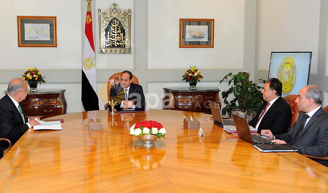 Egyptian President Abdel Fattah al-Sisi meets with Egyptian Prime Minister Sharif Ismail, in Cairo, Egypt, on January 1, 2017. Photo by Egyptian President Office