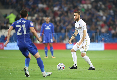26th September 2017, Cardiff City Stadium, Cardiff, Wales; EFL Championship football, Cardiff City versus Leeds United; Mateusz Klich of Leeds United looks to play the ball as he is approached by Craig Bryson of Cardiff City