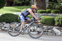 A triathlete heads out onto the bike course at the annual Chelanman Multisport Weekend