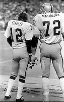 Raiders Ken Stabler and lineman John Matuszak on the sideline in Seattle after loss. (1978 photo/Ron Riesterer)