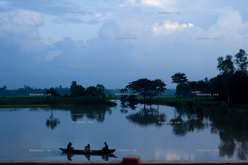 Men head home by boat after a day of work in rural Bangladesh near Bogra, northern Bangladesh on 19th September 2011. Photo by Suzanne Lee for The Guardian