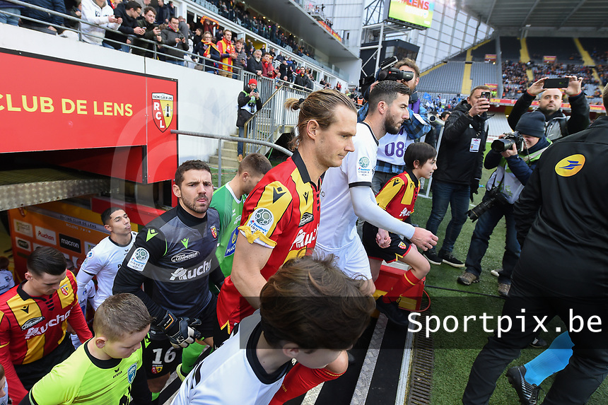 20191221 - LENS , FRANCE : Lens's players Guillaume Gillet (M) and Jean-Louis Leca (GK) entering the pitch pictured during the soccer match between Racing Club de LENS and Niort , on the 19 th matchday in the French Ligue 2 at the Stade Bollaert Delelis stadium , Lens . Saturday 21 December 2019. PHOTO DIRK VUYLSTEKE | SPORTPIX.BE