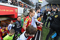 20191221 - LENS , FRANCE : Lens's players Guillaume Gillet (M) and Jean-Louis Leca (GK) entering the pitch pictured during the soccer match between Racing Club de LENS and Niort , on the 19 th matchday in the French Ligue 2 at the Stade Bollaert Delelis stadium , Lens . Saturday 21 December 2019. PHOTO DIRK VUYLSTEKE   SPORTPIX.BE
