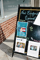 A sign on a sidewalk sandwich board announces former Pennsylvania senator and Republican presidential candidate Rick Santorum's town hall campaign event at the Concord office of New England College in Concord, New Hampshire.