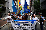 JUNE 29, 2019 - Activists for China Uyghur ethnic minority and pro-democracy activists from Hong Kong march together at a demonstration during the G20 Summit in Osaka, Japan. (Photo by Ben Weller/AFLO) (JAPAN) [UHU]