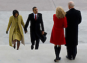 Washington, DC - January 20, 2009 -- United States President Barack Obama walks back to the US Capitol alongside his wife, Michelle, and US Vice President Joe Biden and his wife, Jill, after former US President George W. Bush and his wife, Laura, left the US Capitol on the presidential helicopter after Obama was sworn in as the 44th US president in Washington, DC, on January 20, 2009. .Credit: Saul Loeb - Pool via CNP