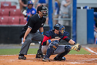 Elizabethton Twins catcher A.J. Murray (22) frames a pitch as home plate umpire Nick Susie looks on during the game against the Kingsport Mets at Hunter Wright Stadium on July 8, 2015 in Kingsport, Tennessee.  The Mets defeated the Twins 8-2. (Brian Westerholt/Four Seam Images)