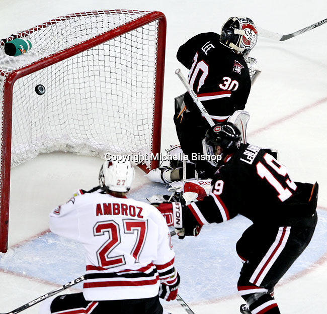 UNO's Matt Ambroz watches as his shot sails into an open net to put UNO up 3-0 in the second period. UNO beat St. Cloud State 3-0 Friday night at Qwest Center Omaha.  (Photo by Michelle Bishop)