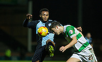 Aaron Holloway of Wycombe Wanderers & Alex Lacey of Yeovil Town go for the ball during the Sky Bet League 2 match between Yeovil Town and Wycombe Wanderers at Huish Park, Yeovil, England on 24 November 2015. Photo by Andy Rowland.