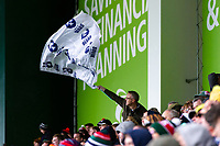 A Bristol Bears fan in the crowd waves a flag in support. Gallagher Premiership match, between Leicester Tigers and Bristol Bears on April 27, 2019 at Welford Road in Leicester, England. Photo by: Patrick Khachfe / JMP
