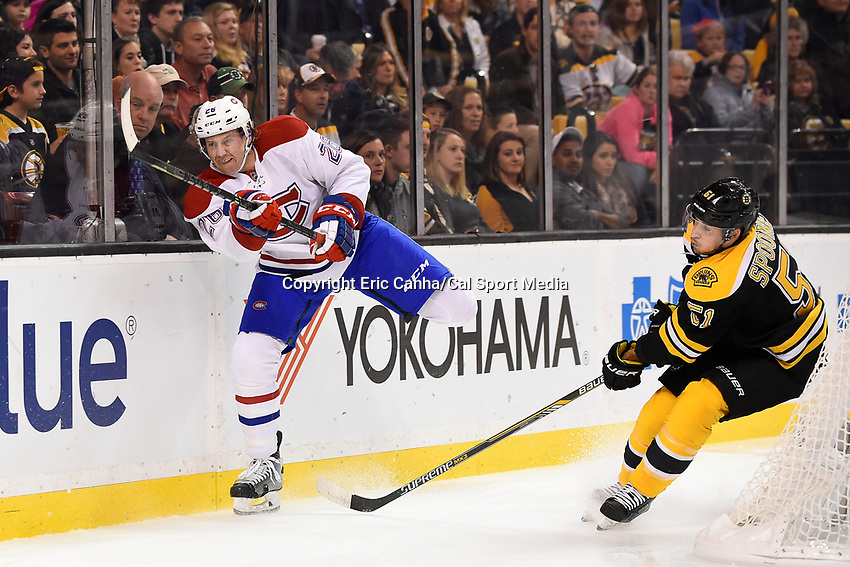 Saturday, October 10, 2105: Montreal Canadiens defenseman Jeff Petry (26) shoots the puck into the corner  during the NHL game between the Montreal Canadiens and the Boston Bruins held at TD Garden, in Boston, Massachusetts. Montreal defeats Boston 4-2 in regulation time. Eric Canha/CSM