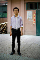 Tangxianhu, a real estate worker, age 19, poses for a portrait in Beijing. Response to 'What does China mean to you?': 'China means the People's Republic of China'  Response to 'What is your role in China's future?': 'Extremely useful.'