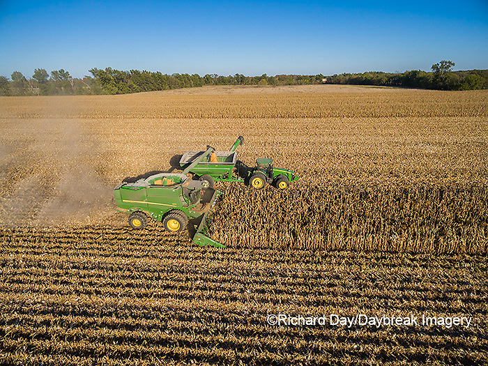 63801-08214 Corn Harvest, John Deere combine unloading corn into grain cart while harvesting - aerial Marion Co. IL