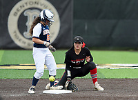 NWA Democrat-Gazette/CHARLIE KAIJO Northside High School Shanoe Teague (11) attempts to tag Rogers Heritage High School Kayla Paulo (15) during the 6A State Softball Tournament, Thursday, May 9, 2019 at Tiger Athletic Complex at Bentonville High School in Bentonville. Rogers Heritage High School lost to Northside High School 8-6
