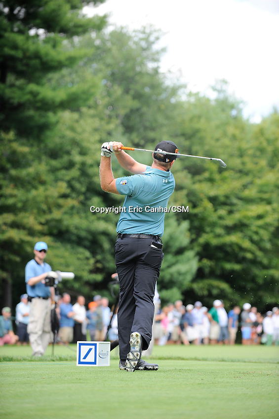 August 29, 2014 -  Norton, Mass. - Hunter Mahan watches the flight of his ball down the 8th fairway during the first round of the PGA Deutsche Bank Championship held at the Tournament Players Club in Norton Massachusetts. Eric Canha/CSM