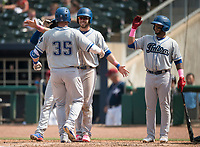 NWA Democrat-Gazette/CHARLIE KAIJO Tulsa Drillers first baseman Peter O'Brien (35) runs home greeted by teammates after scoring a home run during a baseball game, Sunday, May 13, 2018 at Arvest Ballpark in Springdale.