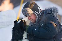 Dog handler shows sled dog some affection before the start of the 2008 Yukon Quest sled dog race in Fairbanks, Alaska.