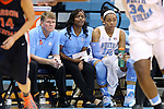 30 October 2013: UNC interim head coach Andrew Calder (left) with assistant coach Ivory Latta and Allisha Gray (15). The University of North Carolina Tar Heels played the Carson-Newman College Eagles in a women's college basketball exhibition game at Carmichael Arena in Chapel Hill, North Carolina. UNC won the preseason game 111-50.
