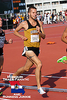 On the last lap with 300 meters to go, Missouri's Dan Quigley fights to improve on his 4th place position in the Big 12 Outdoor Track and Field Championships 5,000 meters in Manhattan, Ks, Sunday. Quigley moved up to second but couldn't catch Oklahoma's George Alex and settled for a runner-up finish in 14:01.84, just 67/100ths of a second behind Alex.