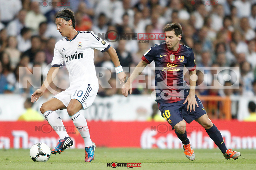 Real Madrid's Ozil and Barcelona's Leo Messi during Super Copa of Spain on Agost 29th 2012...Photo:  (ALTERPHOTOS/Ricky) Super Cup match. August 29, 2012. <br />