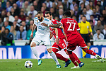 Karim Benzema (L) of Real Madrid is tackled by David Alaba (R) and Mats Hummels of FC Bayern Munich during the UEFA Champions League Semi-final 2nd leg match between Real Madrid and Bayern Munich at the Estadio Santiago Bernabeu on May 01 2018 in Madrid, Spain. Photo by Diego Souto / Power Sport Images