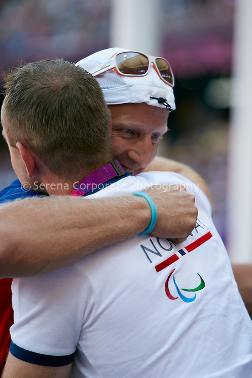 Norway's Runar Steinstad hugs his coach after placing third and taking bronze in the men's T42 Javelin at the London Paralympic Games - Athletics 7.9.12.