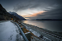 Turnagain Arm receives the first patches of winter light as the sun rises over Cook Inlet just south of Anchorage, Alaska.