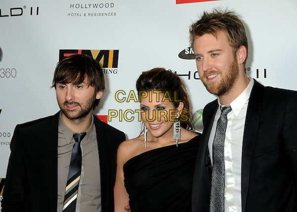 LADY ANTEBELLUM - Dave Haywood, Hillary Scott & Charles Kelley .EMI Post Grammy Party 2010 held at the W Hollywood Hotel, Hollywood, California, USA, 31st January 2010..portrait headshot black one shoulder  dangly earring silver tie beard facial hair grammys .CAP/ADM/BP.©Byron Purvis/Admedia/Capital Pictures