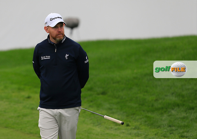 Stephen Gallacher (SCO) on the 18th green during Round 2 of the BMW Masters at Lake Malaren Golf Club in Boshan, Shanghai, China on Friday 13/11/15.<br /> Picture: Thos Caffrey | Golffile<br /> <br /> All photo usage must carry mandatory copyright credit (&copy; Golffile | Thos Caffrey)