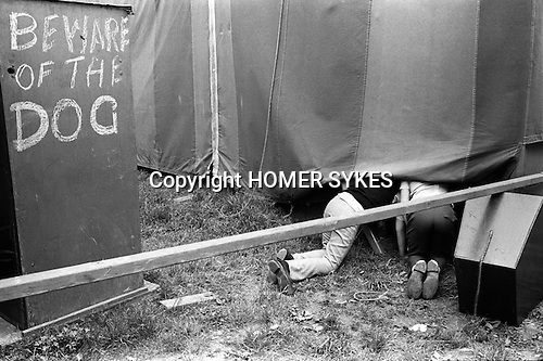 "Beware of the dog. Derby Day fair,  Epsom Down  , Surrey England 1970. Kids looking into the ""Beer Tent""."