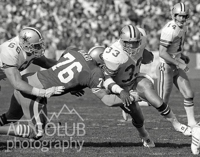 San Francisco 49ers vs. Dallas Cowboys at Candlestick Park Sunday, December 22, 1985..49ers beat the Cowboys 31-16.San Francisco 49ers Defensive End Dwaine Board (76) tackles Dallas Cowboys Running Back Tony Dorsett (33).