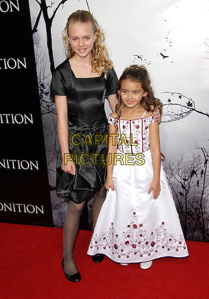 "COURTNEY TAYLOR BURNESS & SHYANNE McCLURE .attends World Premiere of Tri Star Pictures' ""Premonition"" held at The Arclight Theatre in Hollywood, California, USA, March 12 2007..full length.CAP/DVS.©Debbie VanStory/Capital Pictures"