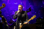 "© Joel Goodman - 07973 332324 . 05/02/2016 . Manchester , UK . PETER HOOK . "" Hacienda Classical "" debut at the Bridgewater Hall . The 70 piece Manchester Camerata and performers including New Order's Peter Hook , Shaun Ryder , Rowetta Idah , Bez and Hacienda DJs Graeme Park and Mike Pickering mixing live compositions . Photo credit : Joel Goodman"